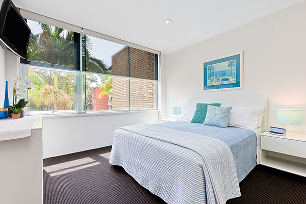 Inside view of bed and window of furnished apartment Chatswood.
